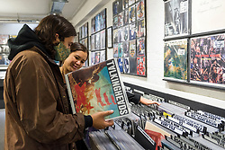 © Licensed to London News Pictures. 29/08/2020. LONDON, UK. Customers browse at Sister Ray Records. Analogue music fans visit independent record shops in Soho to celebrate vinyl music on the rescheduled 13th Record Store Day, originally planned for April, but postponed due to the coronavirus pandemic.  Over 200 independent record shops across the UK come together annually to celebrate the unique culture of analogue music with special vinyl releases made exclusively for the day.  Sales of vinyl have risen, with 4.3m records sold in the UK during 2019, more than a 12-fold increase on the levels seen in 2011. Photo credit: Stephen Chung/LNP