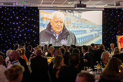 Tony Rowe OBE features in a video as guests watch an video introduction to the Exeter Chiefs Foundation - Ryan Hiscott/JMP - 06/08/2018 - RUGBY - Sandy Park - Exeter, England - Exeter Chiefs Season Launch Dinner
