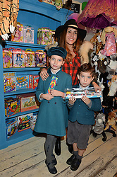 LONDON, ENGLAND 1 DECEMBER 2016: Lily Hodges, Lola-Sofia Hodges, Jonathan Hodges at the 10th birthday party for the toy shop HoneyJam, 2 Blenheim Crescent, Notting Hill, London, England. 1 December 2016.