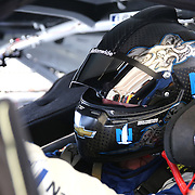 Sprint Cup Series driver Dale Earnhardt Jr. (88) is seen in his car during the 57th Annual NASCAR Coke Zero 400 practice session at Daytona International Speedway on Friday, July 3, 2015 in Daytona Beach, Florida.  (AP Photo/Alex Menendez)
