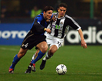 Photo. Javier Garcia<br />11/03/2003 Inter Milan v Newcastle, Champions League Second Phase, San Siro<br />Laurent Robert puts pressure on Inter skipper Javier Zanetti