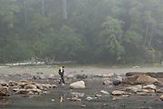 Zach Podell-Eberhardt walks through shallow water on the continental shelf near Bonilla Point, West Coast Trail, British Columbia, Canada.