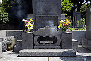 incense burning at family grave Japan