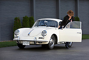 Image of Renee Crist getting into her Porsche 356 at the LeMay Museum in Tacoma, Washington, Pacific Northwest by Randy Wells