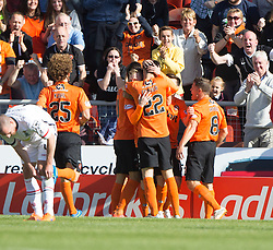 Dundee United's Billy McKay (hidden) cele scoring their goal. <br /> Half time : Dundee United 1 v 0 Inverness Caledonian Thistle, SPFL Ladbrokes Premiership game played 19/9/2015 at Tannadice.