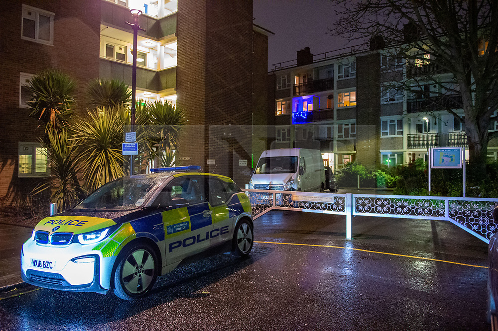 © Licensed to London News Pictures. 18/02/2020. London, UK. A police vehicle sits on St Mark's Grove outside a block of flats where police were called to at around 18:50GMT on Monday, 17 February. London Ambulance Service reported they had been called to an unresponsive man inside a property. A 54-year-old-man was found with head injuries at the premises. He was pronounced dead at the scene. Photo credit: Peter Manning/LNP