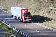 MAN Transport and Forwarding heavy good vehicle on A12 road, Suffolk, England