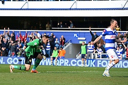 Leeds United's Jack Butland looks on as QPR's Clint Hill celebrates a goal - Photo mandatory by-line: Mitchell Gunn/JMP - Tel: Mobile: 07966 386802 01/03/2014 - SPORT - FOOTBALL - Loftus Road - London - Queens Park Rangers v Leeds United - Championship