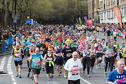 © Licensed to London News Pictures. 24/04/2016. London, UK. Spectators watch fancy dress and mass runners run along The Highway towards Shadwell at the 2016 London Marathon.  Photo credit : Vickie Flores/LNP
