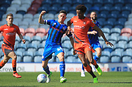 Ian Henderson wins the ball during the EFL Sky Bet League 1 match between Rochdale and Wycombe Wanderers at Spotland, Rochdale, England on 19 April 2019.