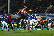 Phil Jones of Manchester United is beaten to the ball by Ashley Williams of Everton. Premier league match, Everton v Manchester United at Goodison Park in Liverpool, Merseyside on Sunday 4th December 2016.<br /> pic by Chris Stading, Andrew Orchard sports photography.