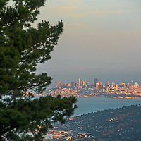 Evening sun lights downtown San Francisco, the Bay Bridge and Sausalito as seen from the summit of Mount Tamalpais.