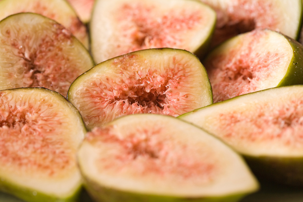 Closeup of sliced juicy red centred fresh figs