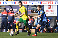 Norwich City midfielder Mario Vrancic (8)  sprints forward with the ball chased by Wycombe Wanderers midfielder Dominic Gape (4) during the EFL Sky Bet Championship match between Wycombe Wanderers and Norwich City at Adams Park, High Wycombe, England on 28 February 2021.