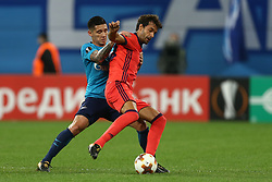 September 28, 2017 - Saint Petersburg, Russia - Matías Kranevitter of FC Zenit Saint Petersburg (L) and Xabi Prieto of FC Real Sociedad vie for the ball during the UEFA Europa League Group L football match between FC Zenit Saint Petersburg and FC Real Sociedad at Saint Petersburg Stadium on September 28, 2017 in St.Petersburg, Russia. (Credit Image: © Igor Russak/NurPhoto via ZUMA Press)
