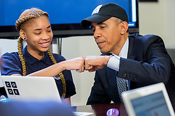 U.S. President Barack Obama fist-bumps middle-school student Adrianna Mitchell while participating in an ?Hour of Code? event in the Eisenhower Executive Office Building next to the White House in Washington, D.C., U.S., on Monday, Dec. 8, 2014. The event is in honor of Computer Science Education Week. Photo by Andrew Harrer/Pool/ABACAPRESS.COM  | 479176_019 Washington Etats-Unis United States