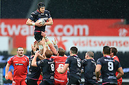 James King of the Ospreys wins a line out ball. Guinness Pro12 rugby match, Ospreys v Scarlets at the Liberty Stadium in Swansea, South Wales on Saturday 26th March 2016.<br /> pic by  Andrew Orchard, Andrew Orchard sports photography.