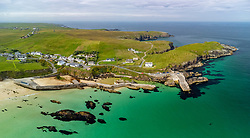 Aerial view from drone of village and harbour at Port Ness at northern tip of Isle of Lewis, Outer Hebrides, Scotland, UK
