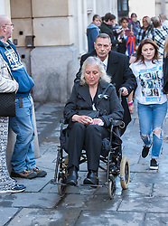 © Licensed to London News Pictures. 13/11/2015. Bristol, UK.  DARREN GALSWORTHY the father of murder victim Rebecca Watts, wheels his wife ANJIE GALSWORTHY, the mother of Nathan Matthews who is accused of Becky Watts' murder, away from Bristol Crown court on the day Nathan Matthews the son of Anjie is sentenced for the murder of Rebecca Watts the daughter of Darren.  Photo credit : Simon Chapman/LNP