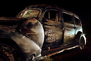 Wall Art of Old Hearse in Tombstone, Arizona. Photo by Colin E. Braley