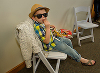 Fashion and Flair with a few pretzels for Connor Hough as he awaits his turn to take the runway in his Gap outfit Sunday afternoon during the Belknap Mill Fashion & Flair Show.  (Karen Bobotas/for the Laconia Daily Sun)