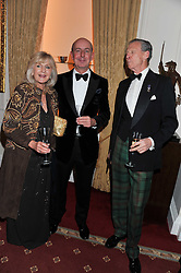 Left to right, LIZ BREWER, MARK LAW and COL.JOHN ROSS at a dinner in aid of Caring For Courage - The Royal Scots Dragoon Guards Afghanistan Welfare Appeal held at The Royal Hospital Chelsea, London SW3 on 20th October 2011.