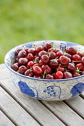 Cherries in blue bowl