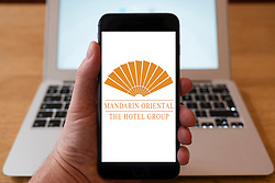 Using iPhone smartphone to display logo of Mandarin Oriental hotels group