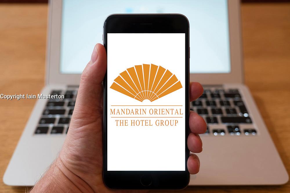 Using iPhone smartphone to display logo of Mandarin Oriental hotels group