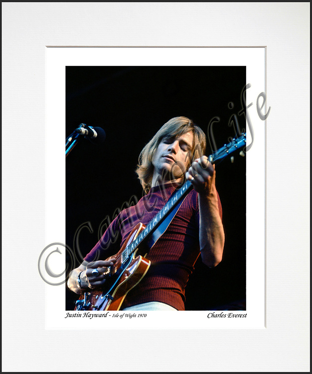 """Justin Hayward- An affordable archival quality matted print ready for framing at home.<br />  Ideal as a gift or for collectors to cherish, printed on Fuji Crystal Archive photographic paper set in a neutral mat (all mounting materials are acid free conservation grade). <br />  The image (approx 6""""x8"""") sits within a titled border. The outer dimensions of the mat are approx 10""""x12"""""""