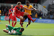 Lenell John-Lewis ® of Newport county is denied a chance by York city keeper Scott Flinders and Dave Winfield.  Skybet football league two match, Newport county v York city at Rodney Parade in Newport, South Wales on Saturday 5th Sept 2015.  pic by Andrew Orchard, Andrew Orchard sports photography.