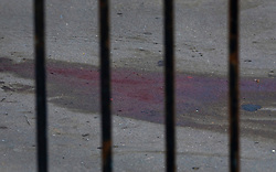 © Licensed to London News Pictures. 01/07/2020. London, UK. Blood stains the floor on the walkway of a block of flats in Monarch Parade in Mitcham, south London where a four year old girl was found seriously injured yesterday. She was taken to hospital where she later died. A woman, aged 35, is fighting for her life after she was also found suffering serious injuries inside the property. Photo credit: Peter Macdiarmid/LNP
