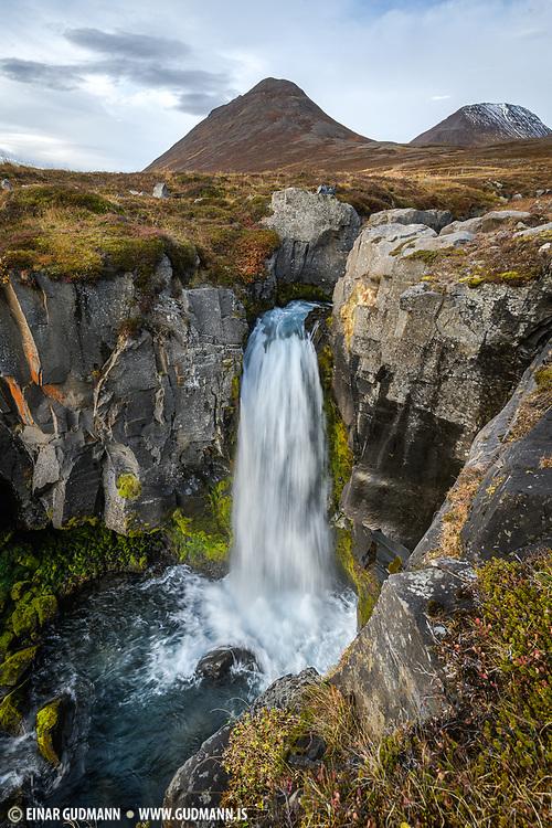 Haifoss waterfall in Horgardalur, North Iceland. Tunguhnjukur, Selhnjukur and Longuhlidarfjall mountains in the background.