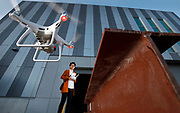 University of Illinois Chicago Masters in Civil Engineering graduate Nalin Naranjo pilots a drone to create 3D models of structures for high quality imagery which is used to look for structural defects in Chicago.