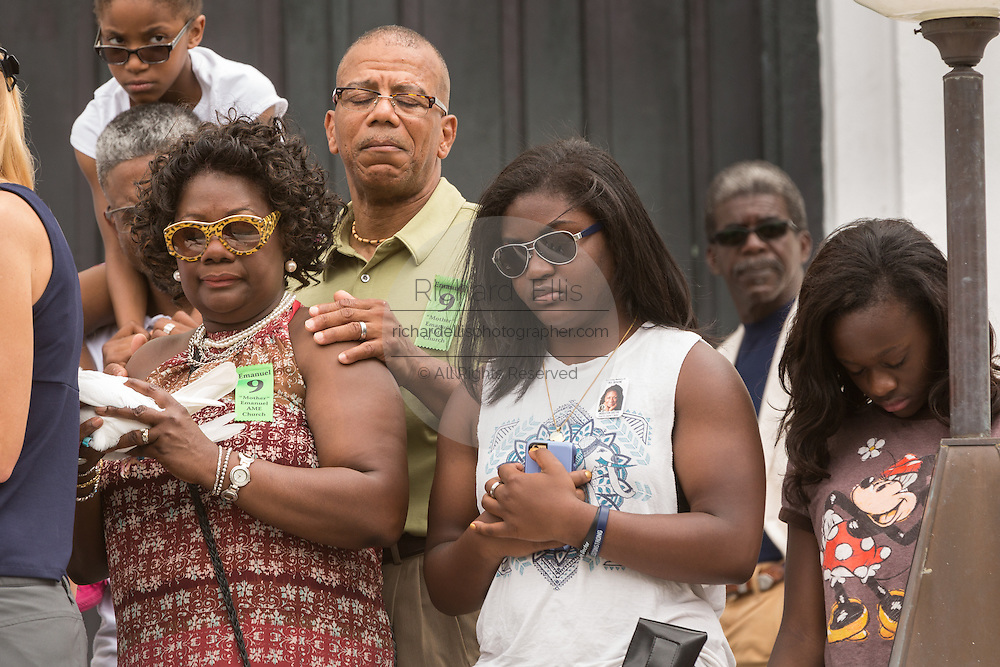 Family members of the Charleston Nine pray during a memorial service at the Mother Emanuel African Methodist Episcopal Church on the anniversary of the mass shooting June 18, 2016 in Charleston, South Carolina. Nine members of the church community were gunned down during bible study inside the church on June 17, 2015.