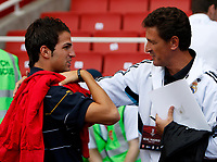 Photo: Richard Lane/Richard Lane Photography. Arsenal v Juventus. Emirates Cup. 02/08/2008. Arsenal's Cesc Fabregas chats to a Real Madrid coach before that game.
