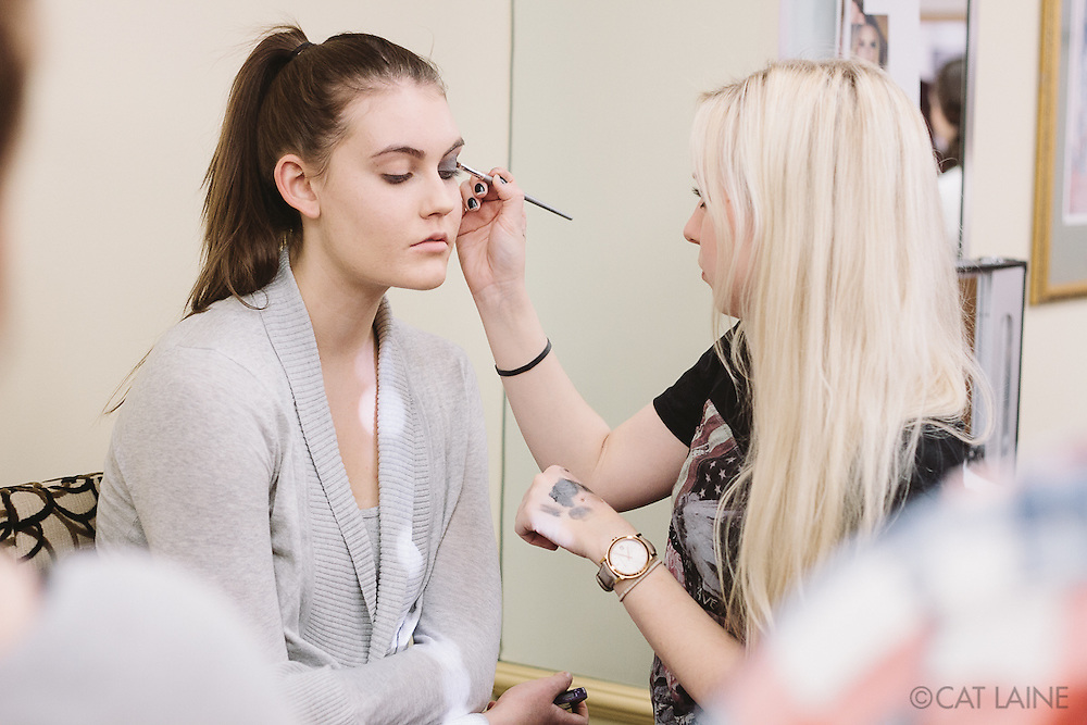 PROVIDENCE, RI - FEB 13: Holly Dalton, StyleWeek NorthEast's Creative Director for Makeup, demonstrates the look for the Alistair Archer show on Sadie Palmer on February 13, 2015 in Providence, RI. (Photo by Cat Laine)