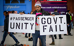 © Licensed to London News Pictures. 15/12/2016. London, UK. Commuters march from Victoria Station to the Department of Transport in London to protest  against ongoing bad service on Southern Rail trains and current industrial action. Negotiations between the rail operator and the train driver's union are due to resume today, in an attempt to prevent further strike action this week.  Photo credit: Ben Cawthra/LNP