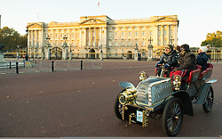 EDITORIAL USE ONLY Participants pass Buckingham Palace during the Bonhams London to Brighton Veteran Car Run in London.