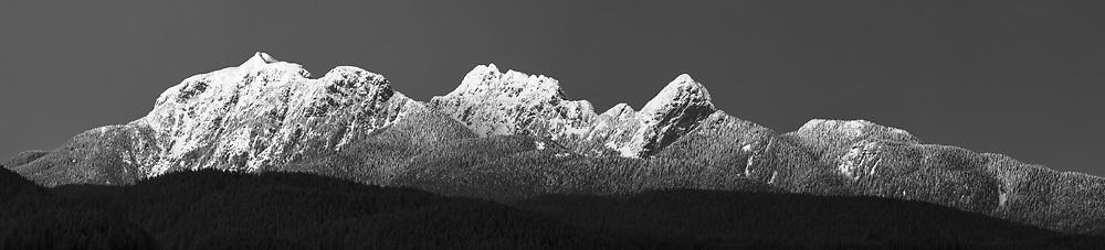 The Golden Ears Mountains in Black and White.  Mount Blanshard, Edge Peak, Blanshard Peak, and Alouette Mountain  make up the Mount Blanshard massif in British Columbia.  Photographed from Pitt Meadows, British Columbia, Canada