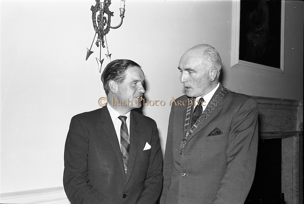 """23/09/1963<br /> 09/23/1963<br /> 23 September 1963<br /> Mr Colm Barnes addressing Rotary Club at the Hibernian Hotel, Dublin. Mr Barnes (left), Chairman of the Institute of Industrial Research and Standards and Joint Managing Director, Glen Abbey Textiles Ltd., who addressed the Dublin Rotary Club on """"Industrial Research"""", with Dr. B.J. Senior, President of the Dublin Rotary Club at the luncheon."""