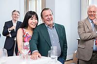 25 JUN 2019, BERLIN/GERMANY:<br /> Gerhard Schroeder (R), SPD, Bundeskanzler a.D., und seine Ehefrau Soyeon Schroeder-Kim (L), Empfang des Seeheimer Kreises anl. des 70. Geburtstages von Ulla Schmidt, mit Gerhard Schroder, Bundeskanzler a.D., Deutsche Parlamentarische Gesellschaft<br /> IMAGE: 20190625-01-097<br /> KEYWORDS: Gerhard Schröder, Soyeon Schröder-Kim