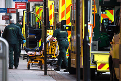 © Licensed to London News Pictures.15/01/2021, London,UK. A patient is stretchered from an ambulance at the Royal London Hospital in east London as the Covid-19 death toll in the UK rose by 1,248 yesterday, the third highest daily increase during the pandemic. Photo credit: Marcin Nowak/LNP