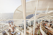 """Royal Caribbean, Harmony of the Seas, The adults-onlySolariumfeatures a three-deck high, glass-paneled enclave designed with seating on various """"islands"""" surrounded by water, providing guests with the sensation of floating on air. The open-air Solarium offers a tranquil swimming pool, two serene whirlpools, and four cantilevered whirlpools suspended 136 feet (41.5 meters) above the ocean."""