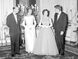 The Queen and the Duke of Edinburgh with their guests President John F Kennedy and his wife Jacqueline, after dinner at Buckingham Palace.