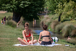 © Licensed to London News Pictures. 20/05/2020. London, UK. Members of the public enjoy the sunshine in Richmond Park in South West London as weather experts predict the warmest day of the Year with a high of 27c. Last week the Government eased the law on lockdown to let people spend more time outside to enjoy sunbathing and picnicking. Photo credit: Alex Lentati/LNP
