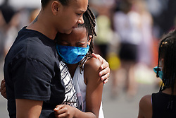 A girl weeps as she visits the site of George Floyd's death near Cup Foods in Minneapolis on Thursday, June 4, 2020. Photo by Anthony Souffle/Minneapolis Star Tribune/TNS/ABACAPRESS.COM