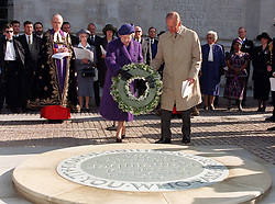 File photo dated 10/10/96 of Queen Elizabeth II, accompanied by the Duke of Edinburgh, laying a wreath on the newly-unveiled memorial to all innocent civilian victims across the world, sited near to the Tomb of the Unknown Warrior at Westminster Abbey, during a ceremony. The Royal couple will celebrate their platinum wedding anniversary on November 20.