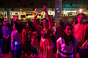People dancing to Asian music during Alchemy, Southbank Centre's annual festival showcasing the best of music, dance, literature, comedy, fashion, art and design from the UK and South Asia. The South Bank is a significant arts and entertainment district, and home to an endless list of activities for Londoners, visitors and tourists alike.