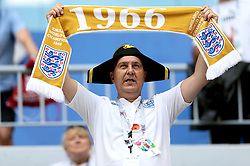 An England fan in the stands holds up a scarf celebrating England's 1966 World Cup win before the FIFA World Cup, Quarter Final match at the Samara Stadium.